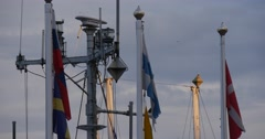 Flags Waving In The Wind White Masts Yach Club Port Harbor Cloudy Summer Day Stock Footage