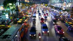 Wide car traffic stream on night street, perspective view from above Stock Footage