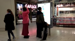 People checking direction map inside shopping mall - stock footage