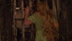 Beautiful Blonde Haired Woman Held Captive In Old Jail Stock Footage