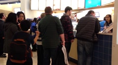 One side of people line up to order juice at orange julius store Stock Footage