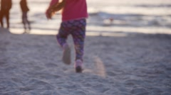 Girl Silhouette is Running Away With Kite People Families Are Walking Beach - stock footage