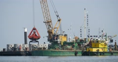 Barges Work In The Sea Big Barge With Crane Yellow-Green Boat Creation Of Dam Stock Footage