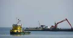 Big Barge With Excavator On The Board Yellow-Green Boat Floats On The Sea Stock Footage