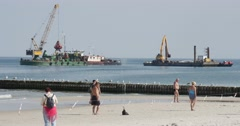 People Walk On The Shore Barge With Crane And Barge With Excavator Work At The Stock Footage