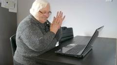 Gambling addiction. Old woman won in online gambling Stock Footage
