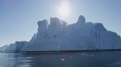 Ilulissat Icefjord Disko Bay UNESCO arctic glacier sun flare - stock footage