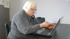 Angry old woman warns the online interlocutor or computer. Funny - stock footage
