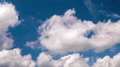 Time lapse of clouds moving through blue sky. 4K resolution Stock Footage