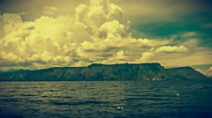 Lake Toba - retro look view of crater with dynamic clouds. Zoom out. 4K Stock Footage