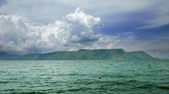 View of Lake Toba with dynamic clouds Stock Footage