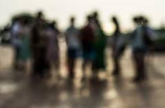 Blurred group of people during sunset Stock Photos