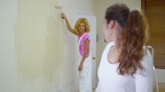 4K Happy young women redecorating at home, one woman turns to camera and smiles - stock footage