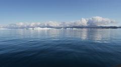 Icebergs Global warming Ecotourism Disko Bay Greenland - stock footage