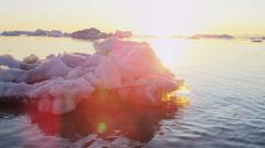 Icebergs Global warming sunset Ecotourism Disko Bay Greenland - stock footage