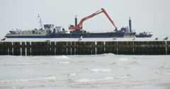Seagulls Sit On The Breakwater Two Barges At The Sea Barge With Excavator Stock Footage