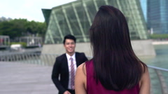 Eager asian young man running towards a girl Stock Footage