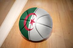 basketball ball with the national flag of algeria - stock photo