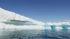 Disko Bay Greenland floating glacial iceberg frozen water - stock footage