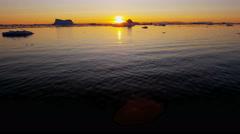 Ilulissat Icefjord Disko Bay sunset UNESCO arctic glacier Stock Footage