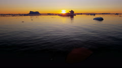 Disko Bay environment sunset ice floes frozen seascape Atlantic - stock footage