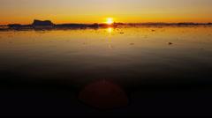 Disko Bay environment sunset ice floes frozen seascape Atlantic - stock footage