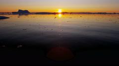 Disko Bay Greenland sunset floating glacial iceberg frozen - stock footage