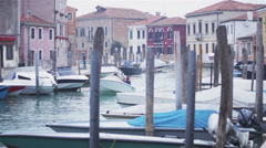 People on boats in a canal in Murano Venice Stock Footage