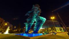 K 30p The runner (Dromeas) sculpture in Athens,Greece, night panning timelapse Stock Footage