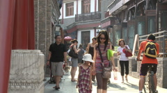 Chinese people walking in old Beijing, China - stock footage