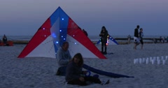 Colorful Kites With Small Colorful Lamps on the Sand Ready to Fly People at the Stock Footage