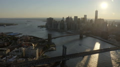 Aerial Manhattan 1 WTC Skyscraper Brooklyn Bridge sunset New York - stock footage