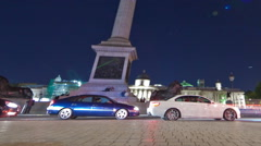 Panning shot of Tracking time-lapse of Nelson's Column in Trafalgar Square, - stock footage