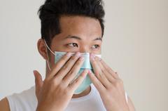 Asian man wearing a face mask Stock Photos