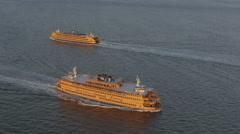 Aerial Staten Island Ferry boats Manhattan 1 WTC Hudson River New York - stock footage
