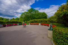 OSLO, NORWAY - 8 JULY, 2015: Gravel plaza in Vigelandsparken with red benches - stock photo