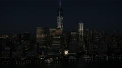 Aerial Manhattan 1 WTC illuminated Financial District night New York - stock footage