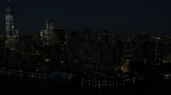 Aerial Manhattan 1 WTC illuminated Skyscrapers Battery Park New York USA - stock footage