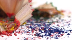 Stock Video Footage of Different crayon shavings isolated on white, close up, slow motion