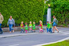 OSLO, NORWAY - 8 JULY, 2015: Group of kindergarden children walking on a line - stock photo