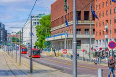 OSLO, NORWAY - 8 JULY, 2015: Public transportation buses passing in front of - stock photo