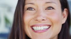 Close up portrait of an attractive young woman smiling slightly off camera Stock Photos