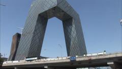 Traffic, CCTV skyscraper, Beijing, China Stock Footage