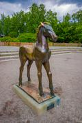 OSLO, NORWAY - 8 JULY, 2015: Statue of a young horse with scared body language - stock photo