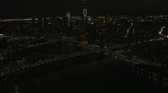 Aerial Manhattan illuminated  1 WTC Brooklyn Bridge Skyscrapers New York USA - stock footage
