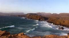 Sea surf on the rocks in the area  Punta Pesebre  on Fuerteventura Stock Footage