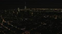 Aerial Manhattan illuminated 1 WTC Brooklyn Bridge Skyscrapers New York - stock footage