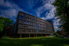 Stock Photo of OSLO, NORWAY - 8 JULY, 2015: Office building mid-size located next to park area