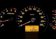 Backlit gauges of a car Stock Photos