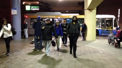 People get out of the bus at Metrotown bus station in Burnaby BC Canada. Stock Footage